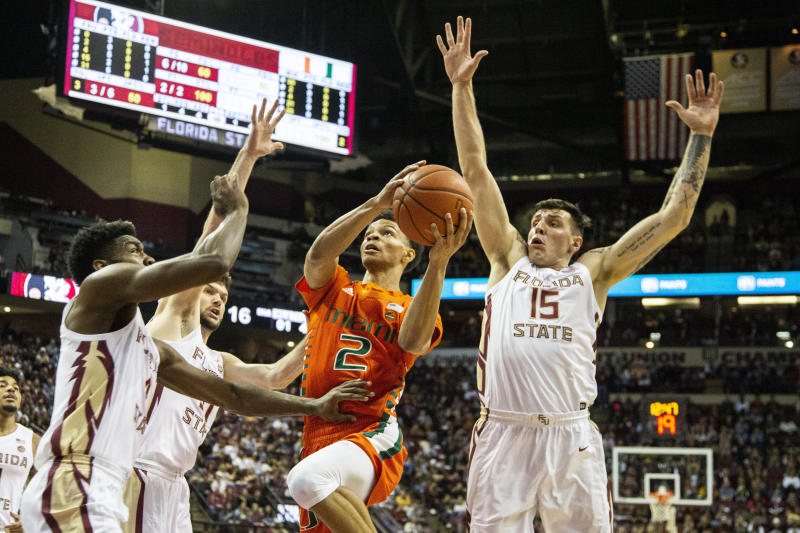 Miami guard Isaiah Wong (2) goes up for a basket against a heavy Florida State defense in the first half of an NCAA college basketball game in Tallahassee, Fla., Saturday, Feb. 8, 2020. (AP Photo/Mark Wallheiser)