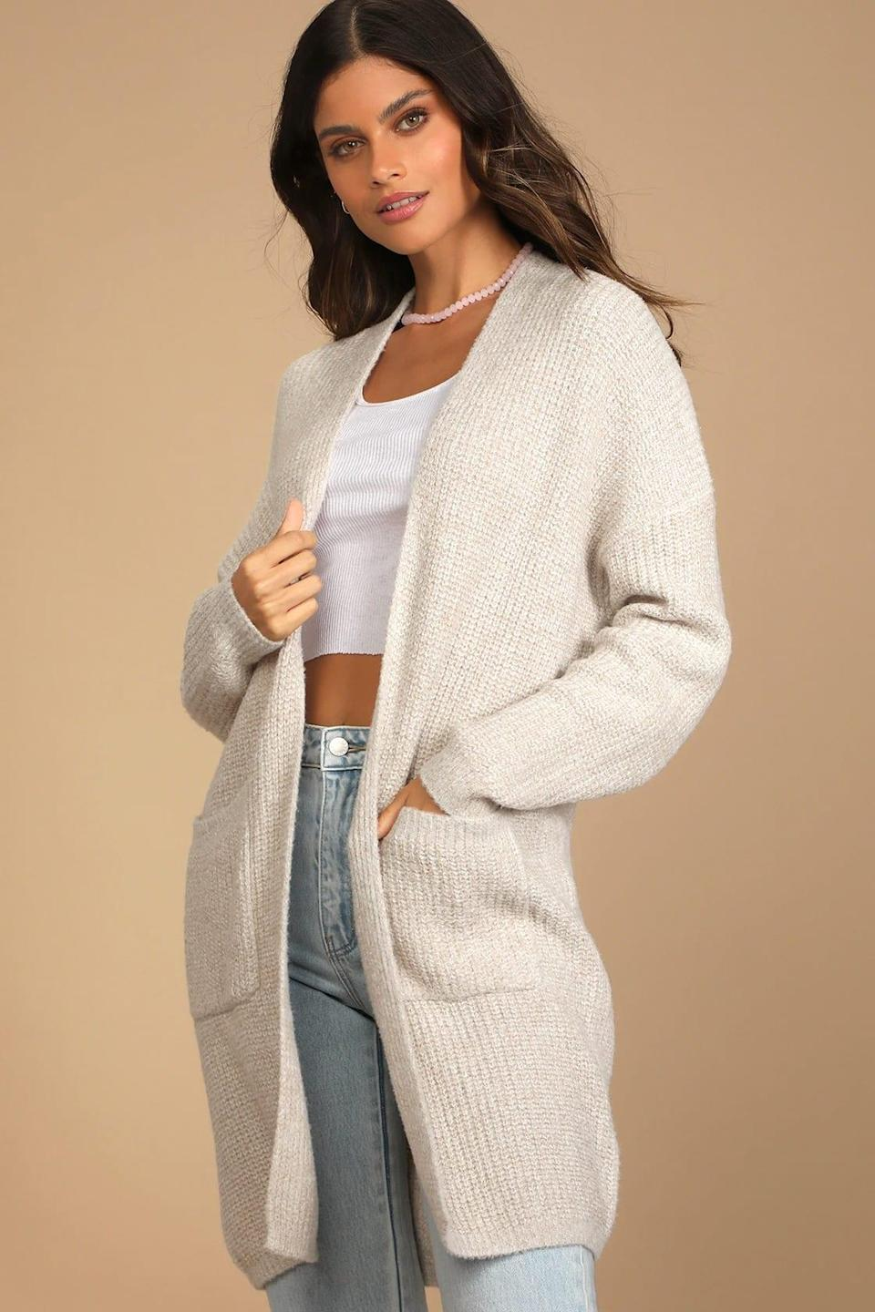 """<br><br><strong>Lulus</strong> Autumn Days Beige Knit Cardigan Sweater, $, available at <a href=""""https://go.skimresources.com/?id=30283X879131&url=https%3A%2F%2Fwww.lulus.com%2Fproducts%2Fautumn-days-beige-knit-cardigan-sweater%2F1545116.html"""" rel=""""nofollow noopener"""" target=""""_blank"""" data-ylk=""""slk:Lulus"""" class=""""link rapid-noclick-resp"""">Lulus</a>"""