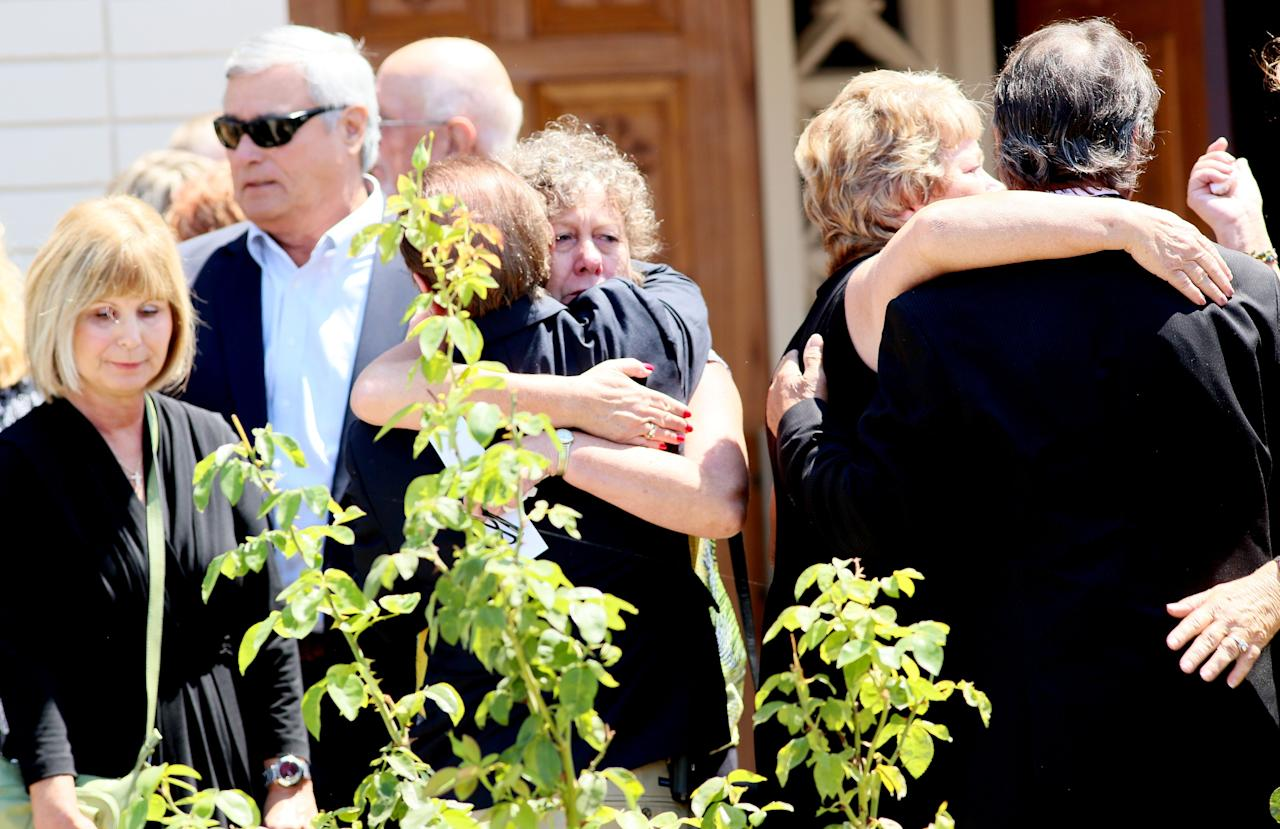 SANTEE, CA - AUGUST 24: People attend a memorial service at the Guardian Angels Catholic Church for Christina Marie Anderson and Ethan Anderson August 24, 2013 in Santee, California. The two were allegedly killed by family friend James Lee DiMaggio, before kidnapping Hannah Anderson earlier this month. Hannah was rescued and DiMaggio was killed in a shoot out with FBI agents in Idaho. (Photo by Sandy Huffaker/Getty Images)