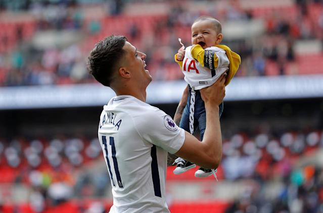 "Soccer Football - Premier League - Tottenham Hotspur vs Leicester City - Wembley Stadium, London, Britain - May 13, 2018 Tottenham's Erik Lamela with his son on a lap of honour after the match Action Images via Reuters/Andrew Couldridge EDITORIAL USE ONLY. No use with unauthorized audio, video, data, fixture lists, club/league logos or ""live"" services. Online in-match use limited to 75 images, no video emulation. No use in betting, games or single club/league/player publications. Please contact your account representative for further details."