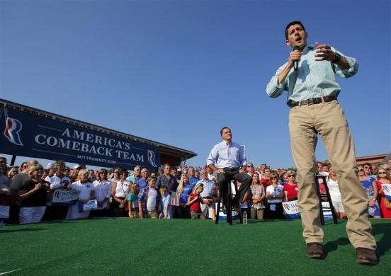 Republican presidential candidate and former Massachusetts Governor Mitt Romney is introduced by vice-presidential candidate Congressman Paul Ryan (R) at a campaign rally in Powell, Ohio August 25, 2012.