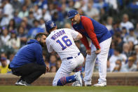Chicago Cubs' Patrick Wisdom (16) is checked on by manager David Ross right, during the second inning of a baseball game against the Cleveland Indians Tuesday, June 22, 2021, in Chicago. Chicago won 7-1. (AP Photo/Paul Beaty)