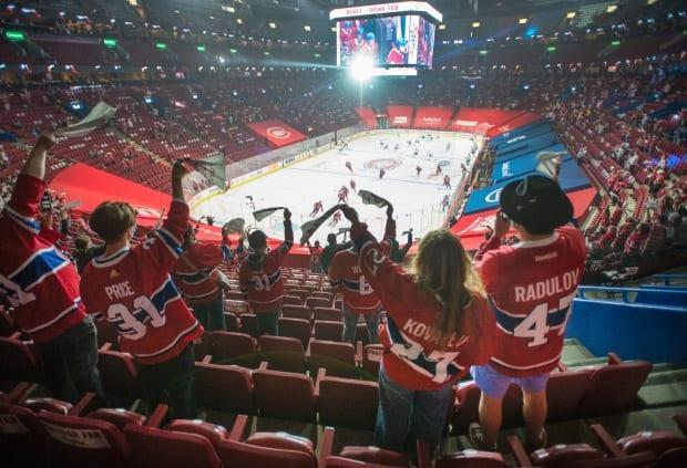 Fans watch the warmup before Game 6 between the Toronto Maple Leafs and the Montreal Canadiens on Saturday at Bell Centre. Quebec's easing of COVID-19 restrictions saw 2,500 mostly partisan fans to attend in the building for the first time in 14 months.