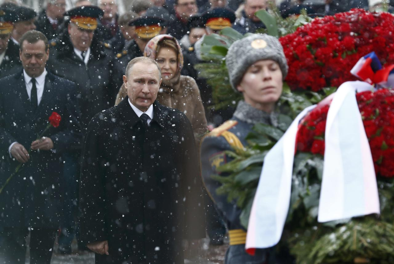 Russian President Vladimir Putin, Prime Minister Dmitry Medvedev and Valentina Matviyenko, the speaker of the Federation Council, the upper house of parliament, attend a wreath laying ceremony to mark the Defender of the Fatherland Day at the Tomb of the Unknown Soldier by the Kremlin wall in central Moscow, Russia February 23, 2017. REUTERS/Sergei Karpukhin