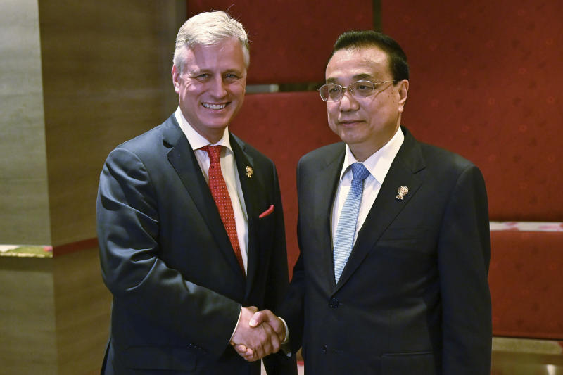 FILE - In this Nov. 4, 2019, file photo, U.S. National Security advisor Robert O'Brien, left, shakes hands with China's Premier Li Keqiang during a bilateral meeting in Bangkok on the sidelines of the 35th Association of Southeast Asian Nations (ASEAN) Summit. The United States and China again traded barbs over freedom of navigation in the South China Sea at the annual summit of leaders of the Association of Southeast Asian Nations in Thailand. (Romeo Gacad/Pool Photo via AP, File)