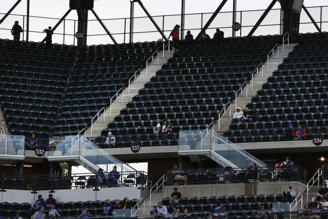 FILE - In this Sept. 30, 2018, file photo, empty seats are seen during a baseball game between the New York Mets and Miami Marlins at Citi Field, in New York. Major League Baseball's attendance dropped to its lowest level since 2003, and six stadiums set record lows. (AP Photo/Jason DeCrow, File)