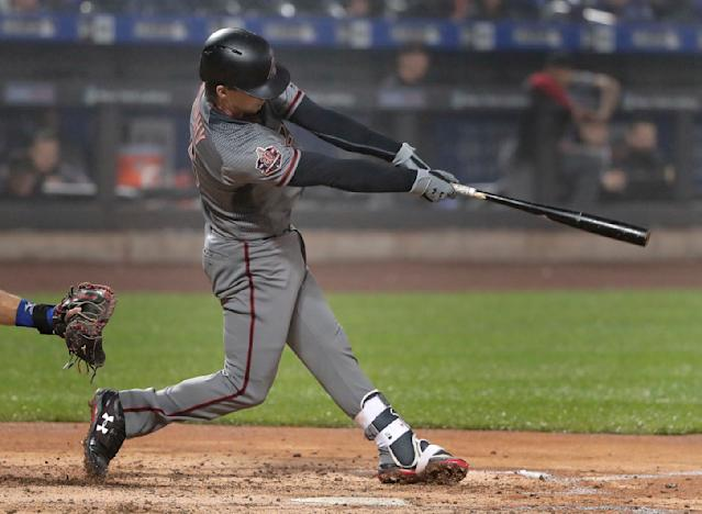 Arizona Diamondbacks' John Ryan Murphy connects for a two-run home run against the New York Mets during the fourth inning of a baseball game, Saturday, May 19, 2018, in New York. (AP Photo/Julie Jacobson)