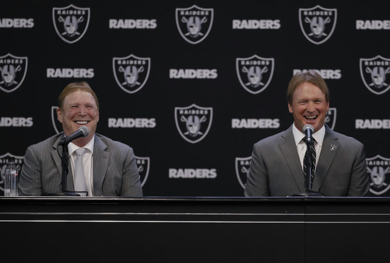 Oakland Raiders owner Mark Davis left may have ignored the Rooney Rule in hiring head coach Jon Gruden. More