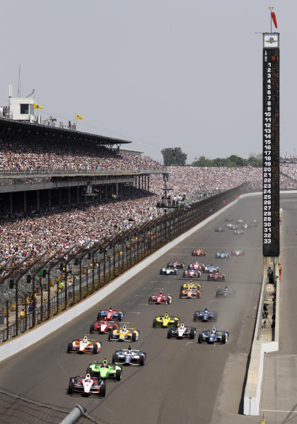 FILE - In this May 27, 2012, file photo, Ryan Briscoe, of Australia, leads the field into the first turn on the opening lap of the Indianapolis 500 auto race at Indianapolis Motor Speedway in Indianapolis. The Hulman-George family should retain ownership of the IndyCar Series and Indianapolis Motor Speedway, according to a report from a consulting group hired by Hulman&Co. to evaluate its business operations, including running the Indianapolis 500. (AP Photo/AJ Mast, File)