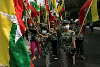 Myanmar's military vowed to abide by the constitution, as its supporters rallied in the street alleging irregularities in the recent election