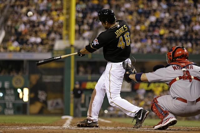 Pittsburgh Pirates' Garrett Jones (46) hits a solo home run off St. Louis Cardinals starting pitcher Shelby Miller (40) during the fourth inning of a baseball game in Pittsburgh Friday, Aug. 30, 2013. (AP Photo/Gene J. Puskar)