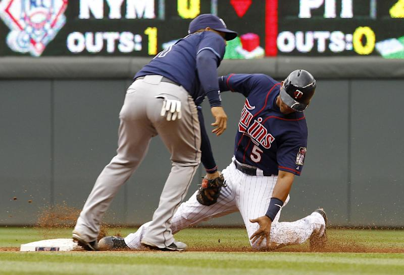 Minnesota Twins' Eduardo Escobar, right, slides into the tag by Tampa Bay Rays shortstop Yunel Escobar, left, and is out attempting to steal second base during the third inning of a baseball game, Sunday, Sept. 15, 2013, in Minneapolis. (AP Photo/Ann Heisenfelt)