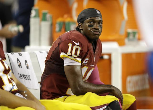 Washington Redskins quarterback Robert Griffin III (10) sits on the bench in the second half of an NFL football game against the Dallas Cowboys, Sunday, Oct. 13, 2013, in Arlington, Texas. (AP Photo/LM Otero)
