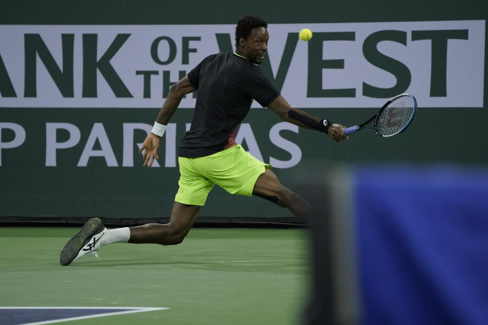 returns a shot to at the BNP Paribas Open tennis tournament Wednesday, Oct. 13, 2021, in Indian Wells, Calif. (AP Photo/Mark J. Terrill)