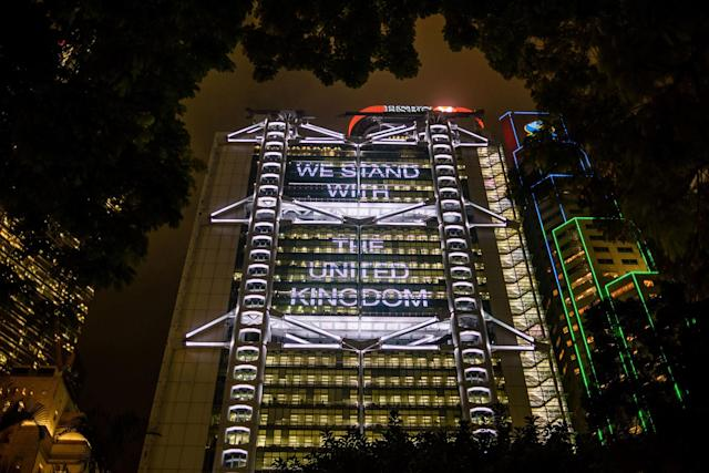 "<p>A message in support of the victims of the attack in Manchester that reads ""We stand with the United Kingdom"" is displayed on the HSBC headquarters building in Hong Kong on May 23, 2017. (Anthony Wallace/AFP/Getty Images) </p>"