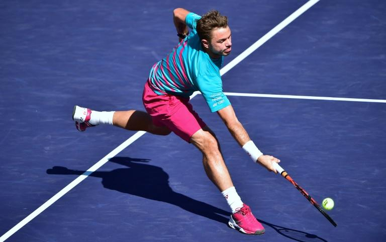 Stan Wawrinka of Switzerland reaches for a forehand return at the net against compatriot Roger Federer during the ATP Indian Wells Masters final match, in California, on March 19, 2017