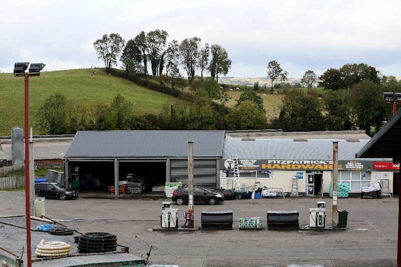 The border cuts directly through the forecourt of Eamon Fitzpatrick's Hardware and Fuel store. In a single day he can cross the border up to 25 times (AFP Photo/PAUL FAITH)