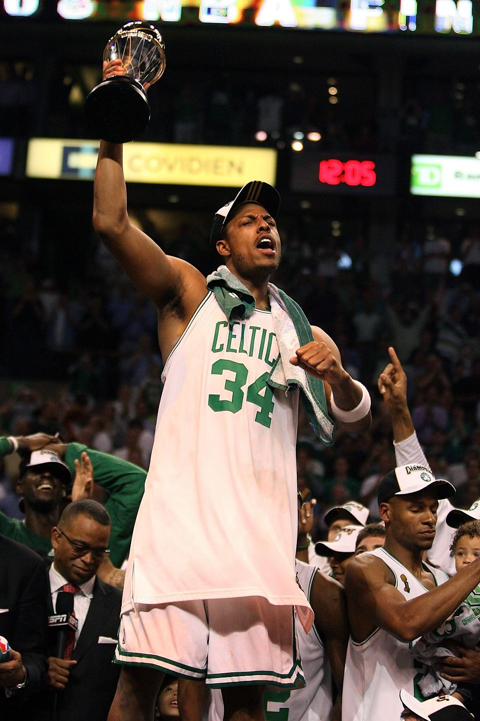 BOSTON - JUNE 17:  Paul Pierce #34 of the Boston Celtics celebrates with the NBA Finals MVP trophy after defeating the Los Angeles Lakers in Game Six of the 2008 NBA Finals on June 17, 2008 at TD Banknorth Garden in Boston, Massachusetts. NOTE TO USER: User expressly acknowledges and agrees that, by downloading and/or using this Photograph, user is consenting to the terms and conditions of the Getty Images License Agreement.  (Photo by Elsa/Getty Images)