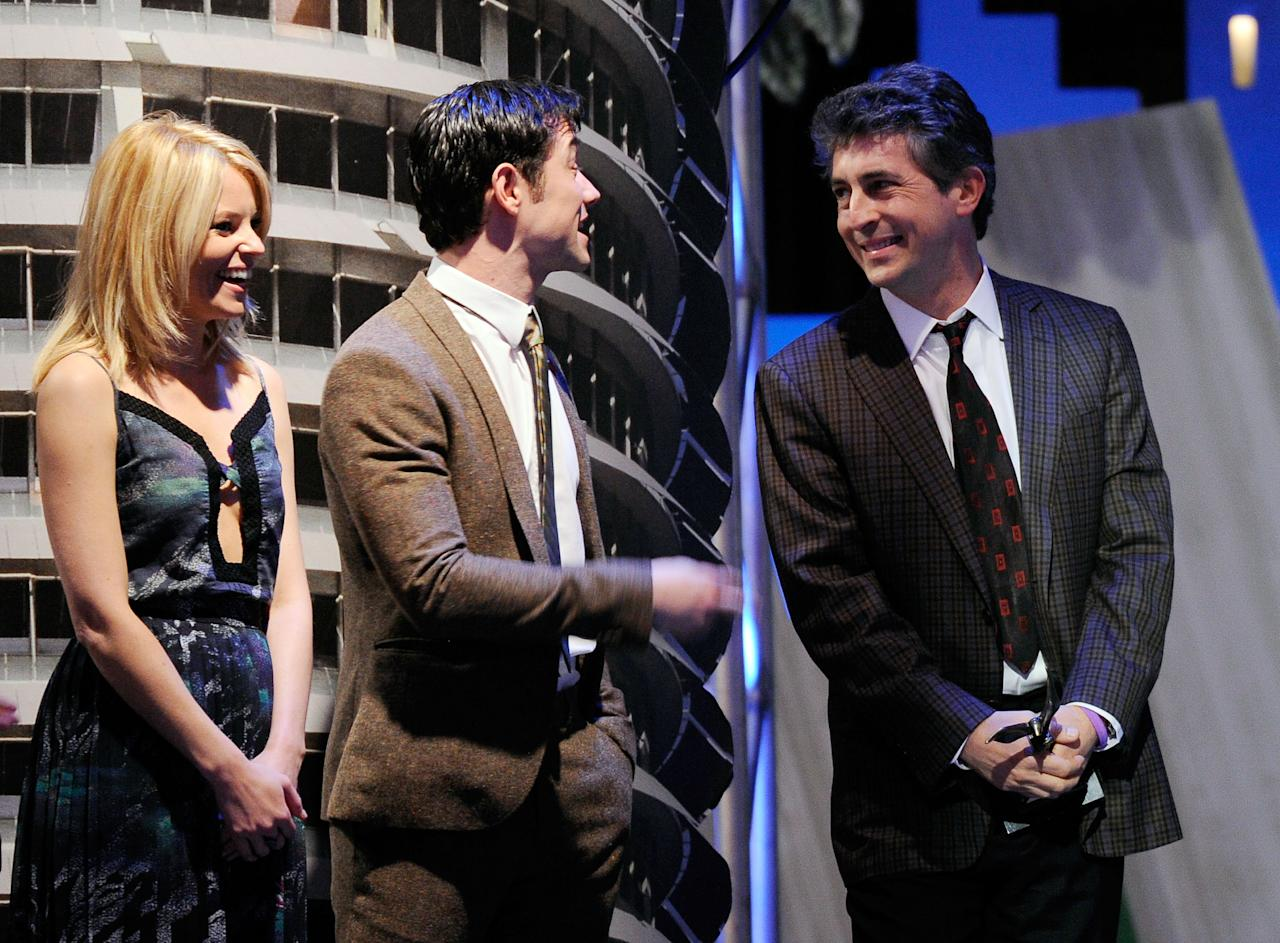 "SANTA MONICA, CA - FEBRUARY 25:  (L-R) Presenters Elizabeth Banks and Joseph Gordon-Levitt and director Alexander Payne, winner of the Best Screenplay award for ""The Descendants"" onstage at the 2012 Film Independent Spirit Awards held at the Santa Monica Pier on February 25, 2012 in Santa Monica, California.  (Photo by Kevork Djansezian/Getty Images)"