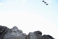 An aerial flypast takes place over Mt. Rushmore during South Dakota's U.S. Independence Day Mount Rushmore fireworks celebrations in Keystone, South Dakota