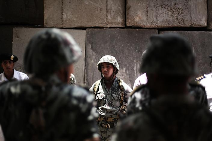 Egyptian military soldiers stand guard outside a polling center in Cairo, Egypt, Thursday, May 24, 2012. In a wide-open race that will define the nation's future political course, Egyptians voted Thursday on the second day of a landmark presidential election that will produce a successor to longtime authoritarian ruler Hosni Mubarak. (AP Photo/Manu Brabo)