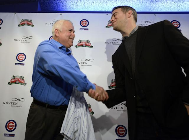 New Chicago Cubs manager Rick Renteria, left, shakes hands with Chicago Cubs president of baseball operations Theo Epstein, right, during a news conference at Wrigley Field in Chicago, Thursday, Dec., 5, 2013. Renteria met with members of the media for the first time since he was hired last month, while recuperating in San Diego from hip surgery. (AP Photo/Paul Beaty)