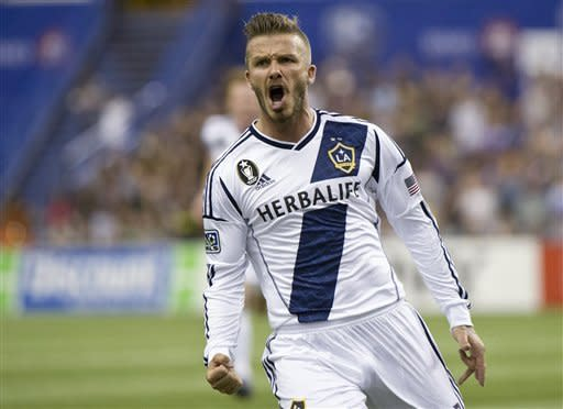 Los Angeles Galaxy's David Beckham celebrates his goal against the Montreal Impact during the second half of an MLS soccer game in Montreal on Saturday, May 12, 2012. (AP Photo/The Canadian Press, Paul Chiasson)