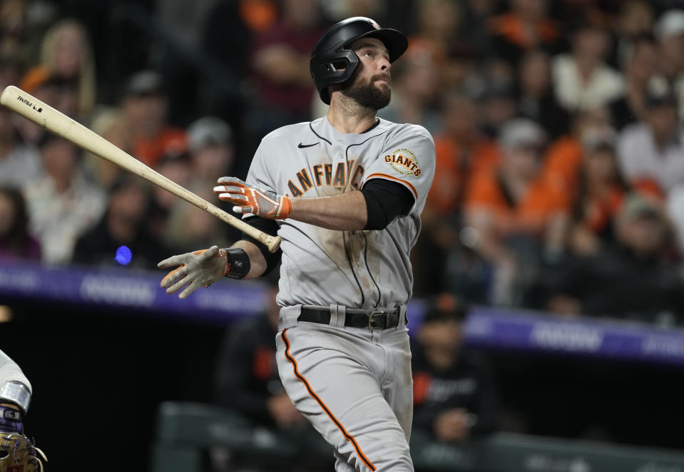 San Francisco Giants' Brandon Belt releases his bat after connecting for a solo home run off Colorado Rockies relief pitcher Ashton Goudeau in the sixth inning of a baseball game Friday, Sept. 24, 2021, in Denver. (AP Photo/David Zalubowski)