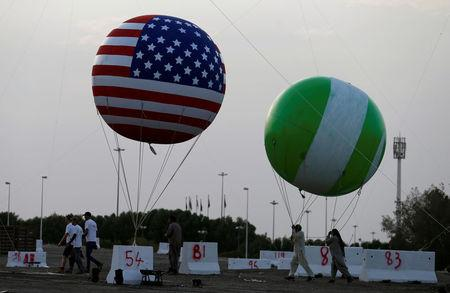 Workers are seen near a balloon with a United States flag on it as part of welcome celebrations ahead of the visit of U.S. President Donald Trump to Saudi Arabia, in Riyadh