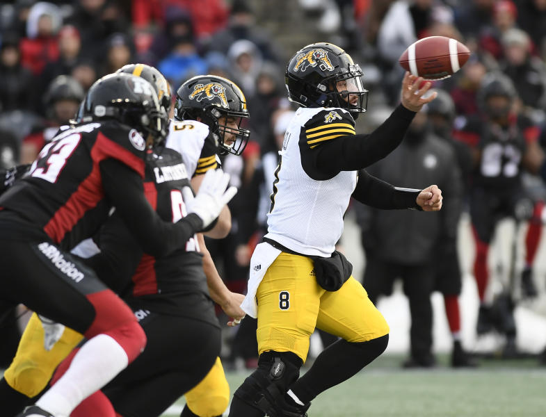 Hamilton Tiger-Cats quarterback Jeremiah Masoli (8) throws the ball during the second half against the Ottawa Redblacks in the Canadian Football League East Division final Sunday, Nov. 18, 2018, in Ottawa, Ontario. (Justin Tang/The Canadian Press via AP)