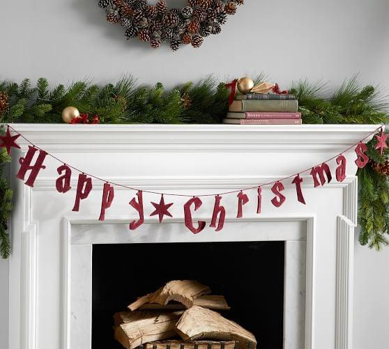 """<p>This <a href=""""https://www.popsugar.com/buy/Harry-Potter-Garland-494025?p_name=Harry%20Potter%20Garland&retailer=potterybarn.com&pid=494025&price=50&evar1=casa%3Aus&evar9=46675172&evar98=https%3A%2F%2Fwww.popsugar.com%2Fphoto-gallery%2F46675172%2Fimage%2F46675305%2FHarry-Potter-Garland&list1=shopping%2Charry%20potter%2Cpottery%20barn%2Chome%20shopping&prop13=api&pdata=1"""" rel=""""nofollow"""" data-shoppable-link=""""1"""" target=""""_blank"""" class=""""ga-track"""" data-ga-category=""""Related"""" data-ga-label=""""https://www.potterybarn.com/products/harry-potter-garland/?pkey=charry-potter-shop&amp;isx=0.0.4393"""" data-ga-action=""""In-Line Links"""">Harry Potter Garland</a> ($50) will add a dash of Christmas cheer to your fireplace.</p>"""