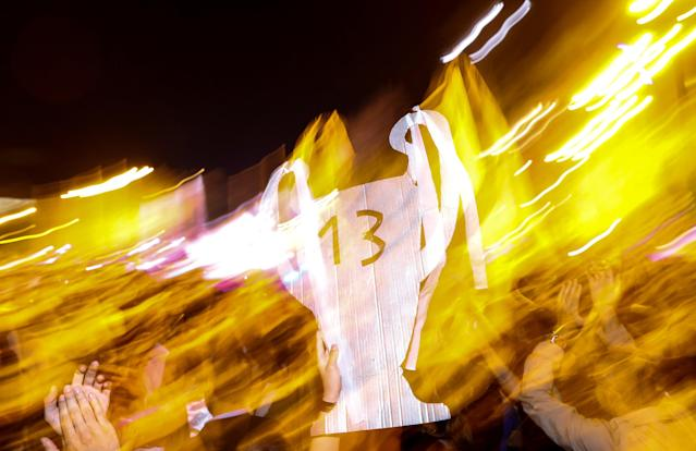 Soccer Football - Real Madrid fans watch the Champions League Final - Madrid, Spain - May 27, 2018 Real Madrid fans celebrate holding up a cardboard trophy with the number 13 near the Cibeles fountain in central Madrid after their team won the Champions League REUTERS/Paul Hanna TPX IMAGES OF THE DAY