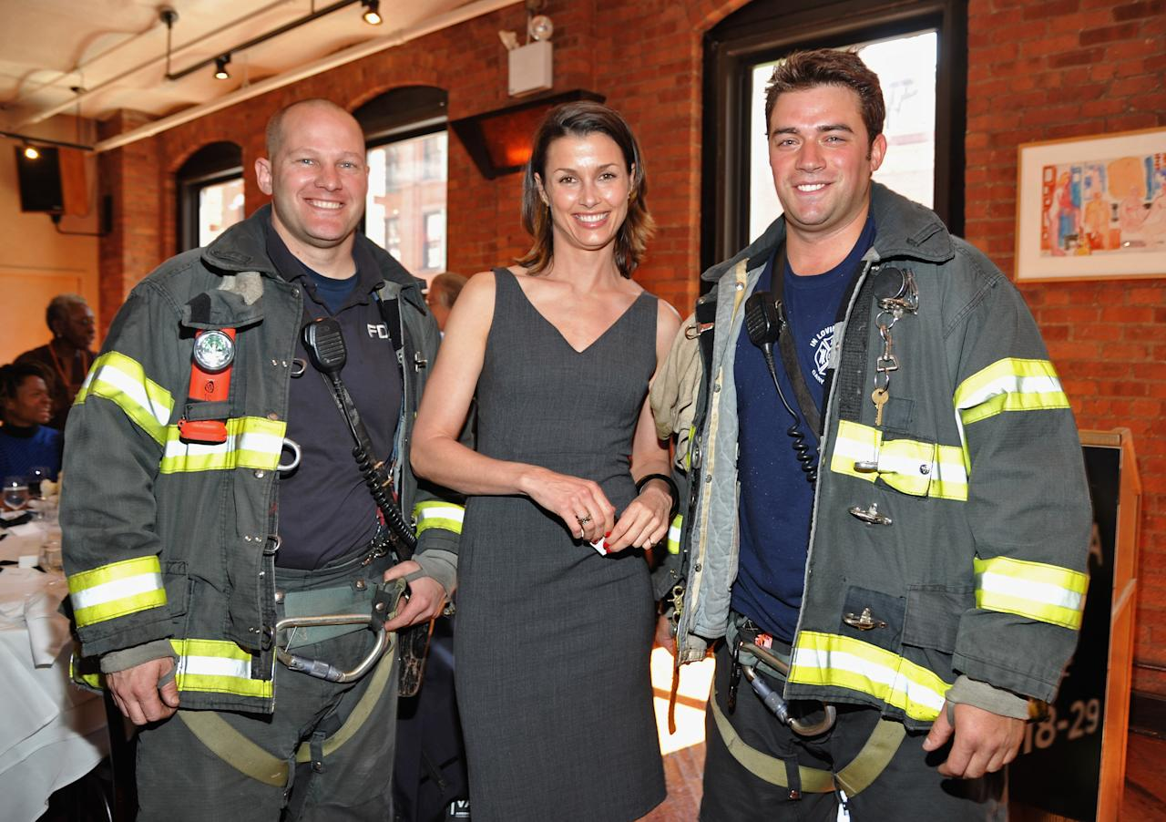 NEW YORK, NY - APRIL 19:  Actress Bridget Moynahan (C) with the NYFD at the 2012 Tribeca Film Festival Jury lunch at the Tribeca Grill Loft on April 19, 2012 in New York City.  (Photo by Mike Coppola/Getty Images for Tribeca Film Festival)