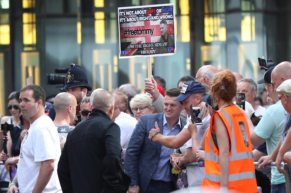 Tommy Robinson (blue jacket centre) arrives at the Old Bailey in London for a committal hearing for alleged contempt of court.