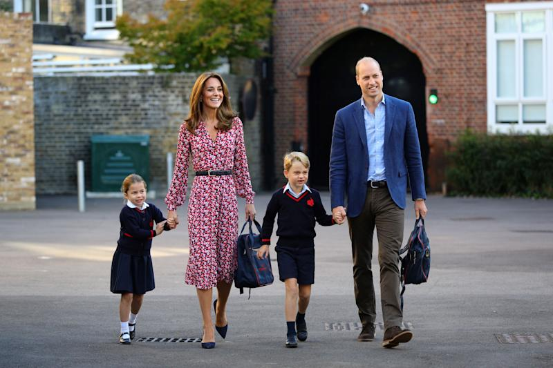 TOPSHOT - Britain's Princess Charlotte of Cambridge, accompanied by her father, Britain's Prince William, Duke of Cambridge, her mother, Britain's Catherine, Duchess of Cambridge and brother, Britain's Prince George of Cambridge, arrives for her first day of school at Thomas's Battersea in London on September 5, 2019. (Photo by Aaron Chown / POOL / AFP) (Photo by AARON CHOWN/POOL/AFP via Getty Images)