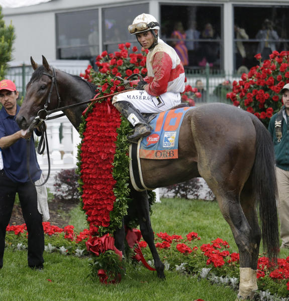 Joel Rosario sits on Orb in the winners circle after winning the 139th Kentucky Derby at Churchill Downs Saturday, May 4, 2013, in Louisville, Ky. (AP Photo/J. David Ake)