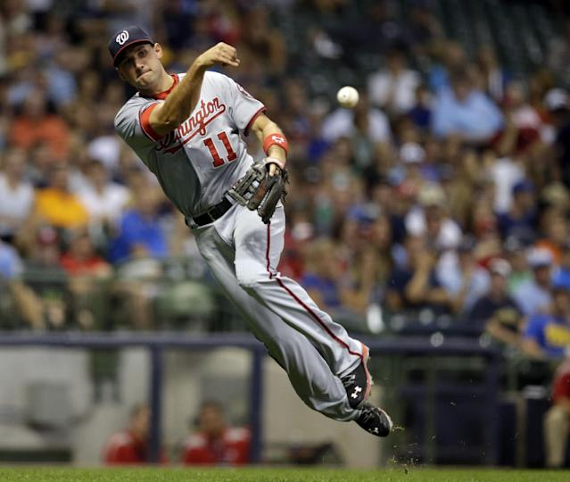 Washington Nationals third baseman Ryan Zimmerman makes a play on a ball hit by Milwaukee Brewers' Scooter Gennett during the fifth inning of a baseball game Friday, Aug. 2, 2013, in Milwaukee. (AP Photo/Morry Gash)