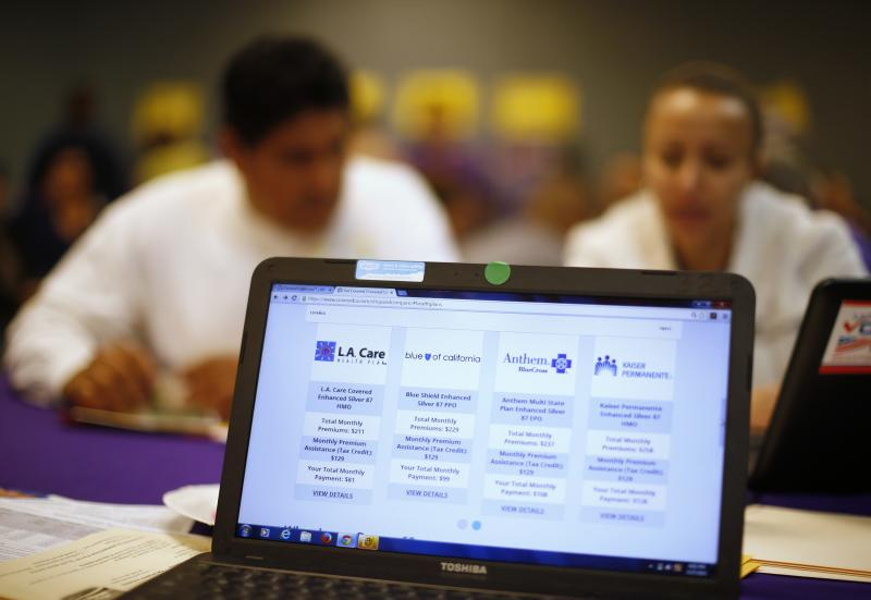 People sign up for health insurance at an enrollment event in Cudahy