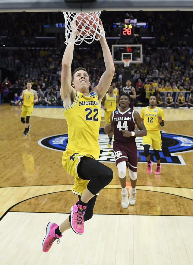 Michigan guard Duncan Robinson (22) dunks against Texas A&M during the first half of an NCAA men's college basketball tournament regional semifinal Thursday, March 22, 2018, in Los Angeles. (AP Photo/Jae Hong)
