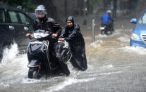 Motorist drive through waterlogged during heavy rain at Parsi colony, Dadar, on July 16, 2020 in Mumbai, India. (Photo by Satish Bate/Hindustan Times via Getty Images)