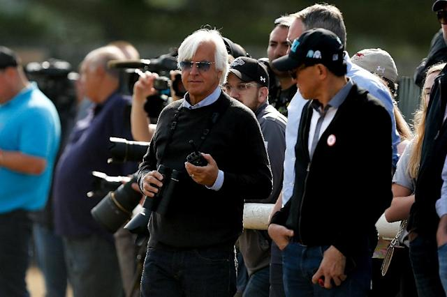 Bob Baffert (C), trainer of Triple Crown and Belmont Stakes contender Justify, seen during morning training prior to the 150th running of the Belmont Stakes, at Belmont Park in Elmont, New York, on June 8, 2018 (AFP Photo/Michael Reaves)