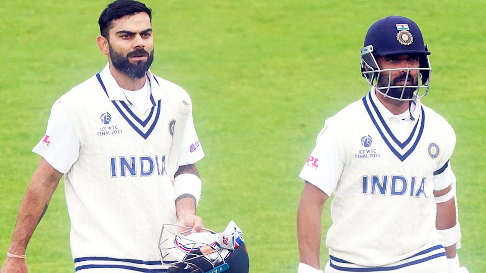 Virat Kohli and Ajinkya Rahane, pictured here walking off the field after bad light stopped play.