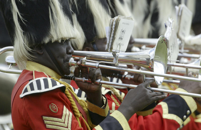 FILE - In this Wednesday, Dec. 12, 2007 file photo, a Kenyan Army band plays during the 44th Jamhuri (Independence) Day celebrations at Nyayo Stadium in Nairobi, Kenya. A government proposal to spend nearly $30 million celebrating the country's 50th year of independence, the anniversary of which will take place on Dec. 12, 2013, is causing an outcry among civil society groups who say the country does not have any reason to celebrate or the financial means to do it. (AP Photo/Sayyid Azim, File)