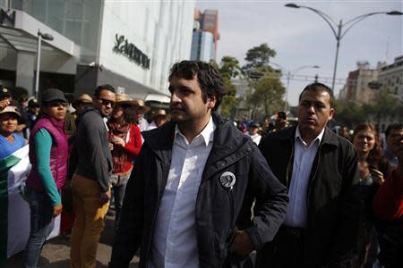 Andres Manuel Lopez Beltran, the son of leftist leader Andres Manuel Lopez Obrador, arrives to a protest against an energy reform bill at the Senate building in Mexico City December 4, 2013. REUTERS/Tomas Bravo