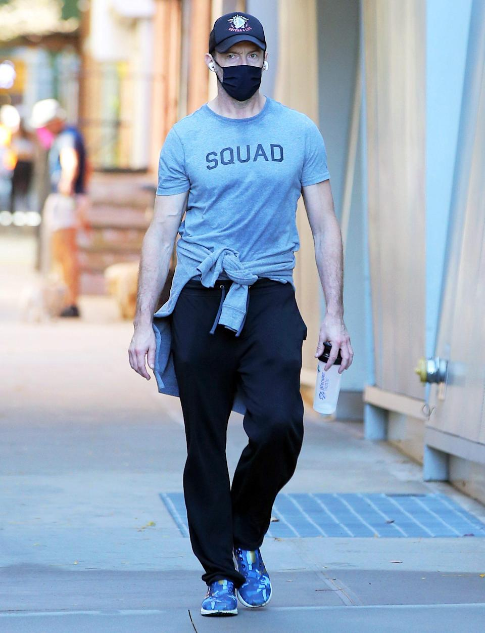 "<p>Hugh Jackman leaves the gym on Tuesday in N.Y.C., wearing a baseball cap, a ""squad"" tee and sneakers.</p>"