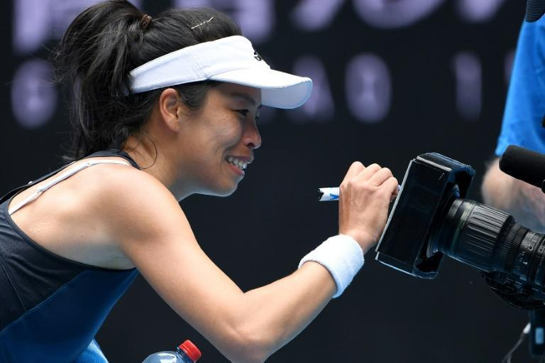 Taiwan's Hsieh Su-wei signs an autograph on a TV camera as she celebrates her victory against Czech Republic's Marketa Vondrousova to reach the quarter-finals of a Slam for the first time at the Australian Open