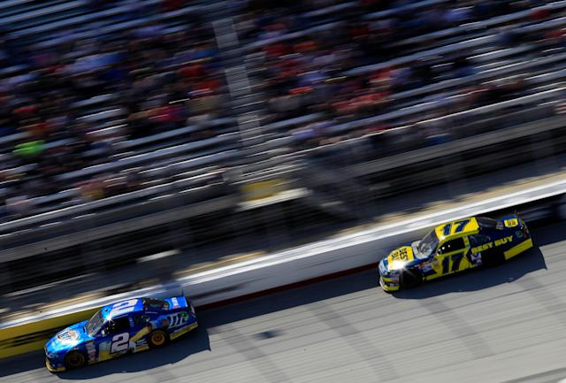 BRISTOL, TN - MARCH 18: Brad Keselowski, driver of the #2 Miller Lite Dodge, leads Matt Kenseth, driver of the #17 Best Buy Ford, during the NASCAR Sprint Cup Series Food City 500 at Bristol Motor Speedway on March 18, 2012 in Bristol, Tennessee. (Photo by Chris Trotman/Getty Images)