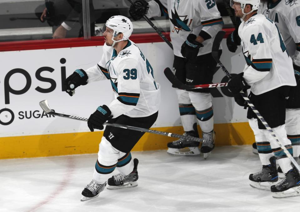 San Jose Sharks center Logan Couture celebrates after scoring an empty-net goal against the Colorado Avalanche during the third period of Game 3 of an NHL hockey second-round playoff series Tuesday, April 30, 2019, in Denver. The Sharks won 4-2. (AP Photo/David Zalubowski)