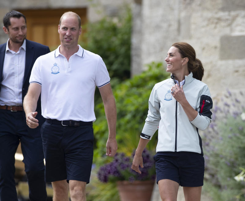 COWES, ENGLAND - AUGUST 08: Prince William, Duke of Cambridge and Catherine, Duchess of Cambridge leave the The Royal Yacht Squadron to head to the presentation during the inaugural Kings Cup regatta hosted by the Duke and Duchess of Cambridge on August 08, 2019 in Cowes, England. Their Royal Highnesses hope that The Kings Cup will become an annual event bringing greater awareness to the wider benefits of sport, whilst also raising support and funds for Action on Addiction, Place2Be, the Anna Freud National Centre for Children and Families, The Royal Foundation, Child Bereavement UK, Centrepoint, Londonís Air Ambulance Charity and Tusk. on August 08, 2019 in Cowes, England. (Photo by Antony Jones/Getty Images)