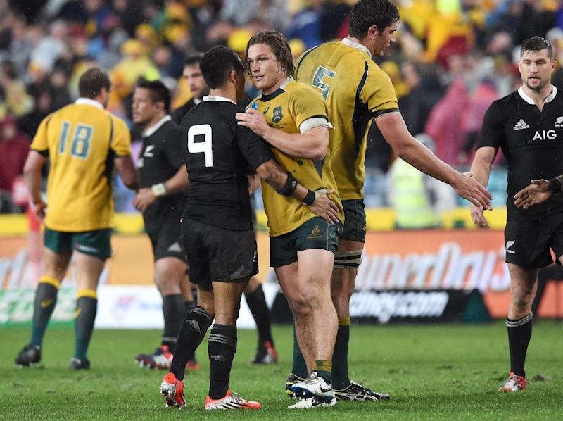 Australian Wallabies captain Michael Hooper (C-R) shakes hands with New Zealand All Blacks halfback Aaron Smith after their rugby union Test match in Sydney, on August 16, 2014